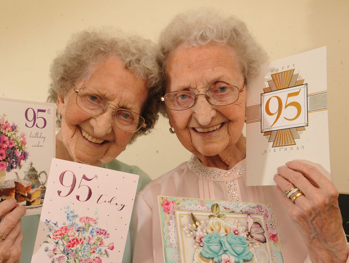 Celebrating their 95th birthday are identical twins Lilian Cox, left, and Doris Hobday