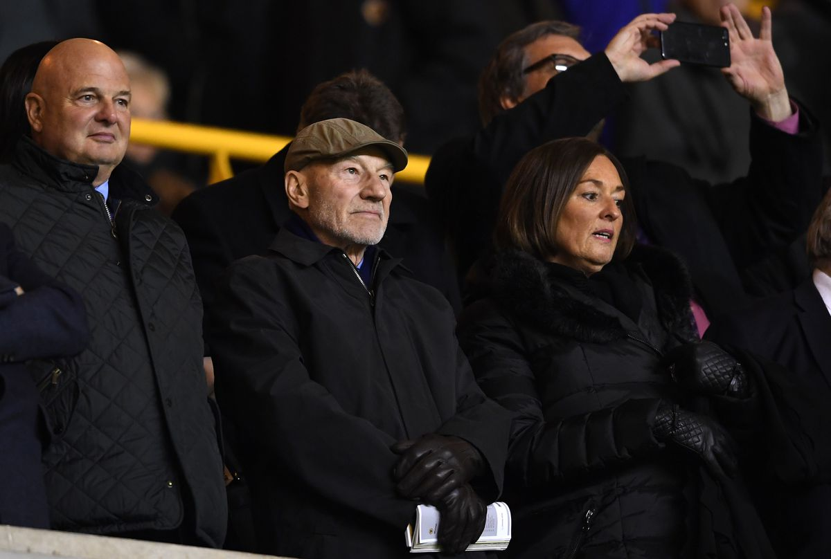 Sir Patrick Stewart OBE and Huddersfield Town fans attends the game