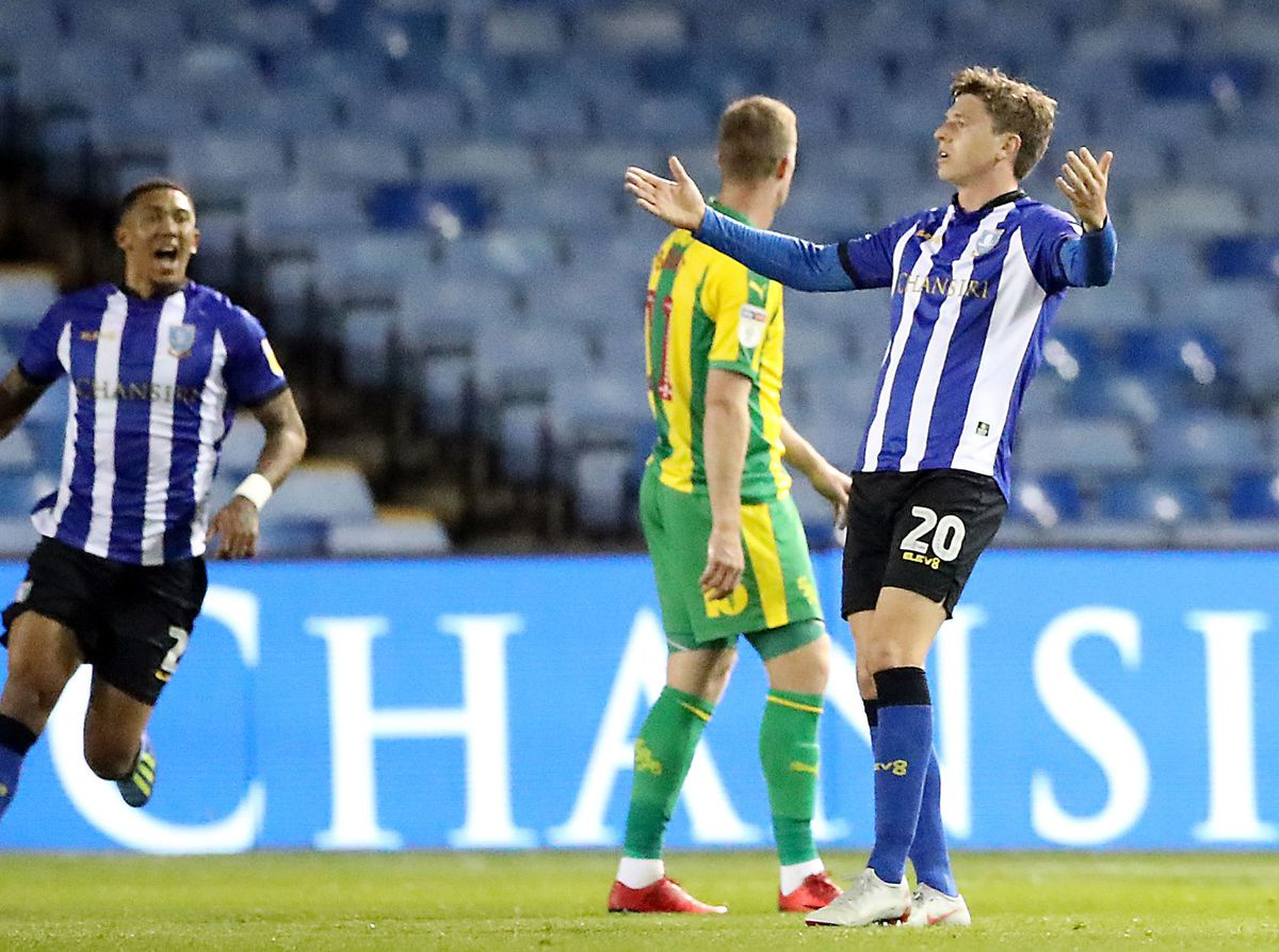 Sheffield Wednesday's Adam Reach (right) celebrates scoring his side first goal