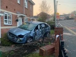 Car smashes through garden wall at Cradley house