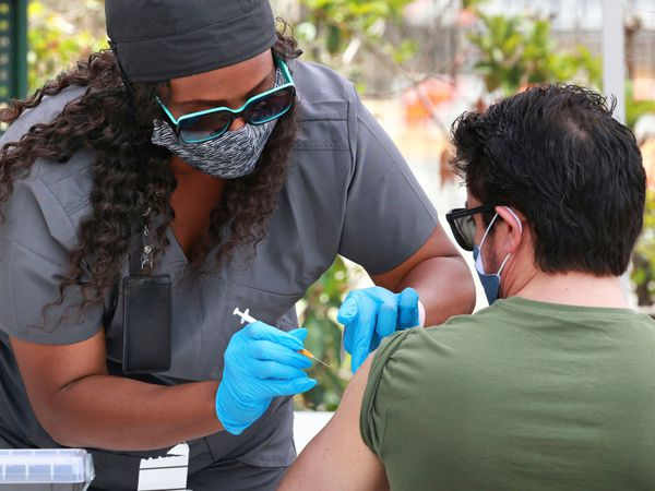 An Orange County resident receives the Covid-19 vaccine in Orlando