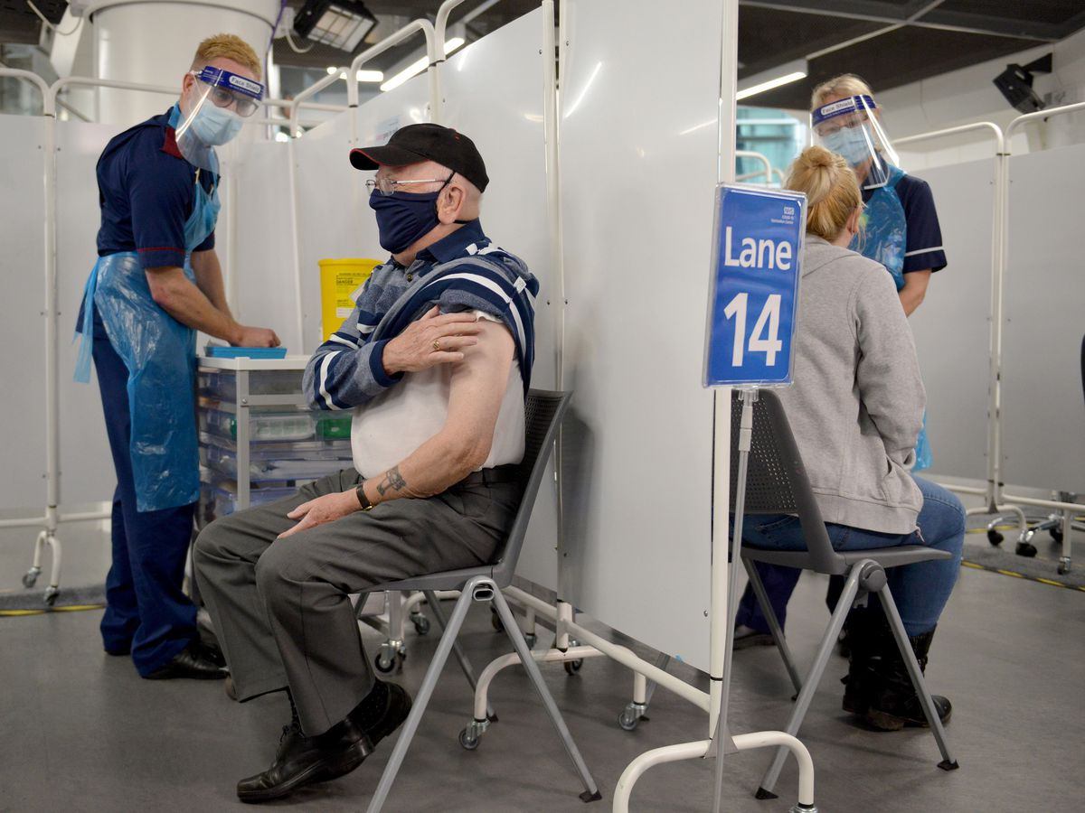 Mass vaccination centre opens at Millennium Point, Birmingham. Pictured, Ken Hughes, ages 82, from Swindon, gets the jab
