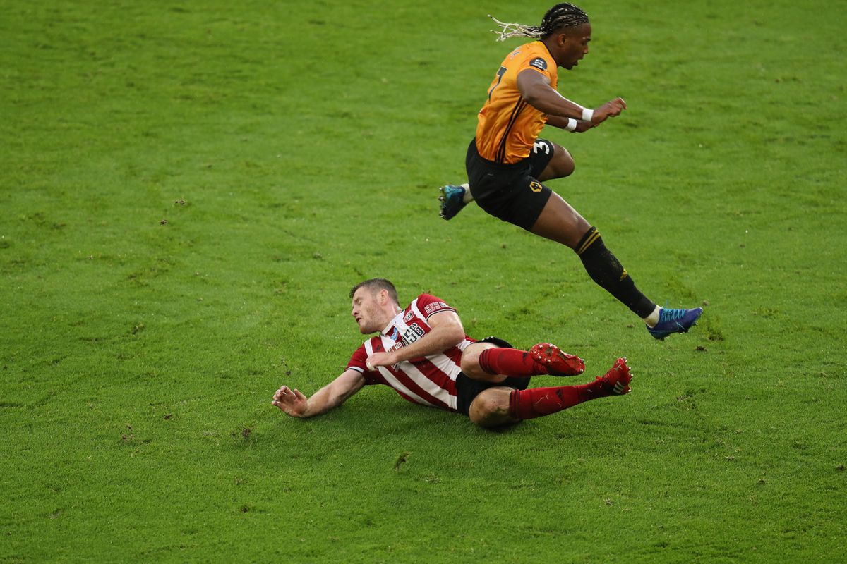 Adama Traore of Wolverhampton Wanderers and Ben Osborn of Sheffield United (AMA)
