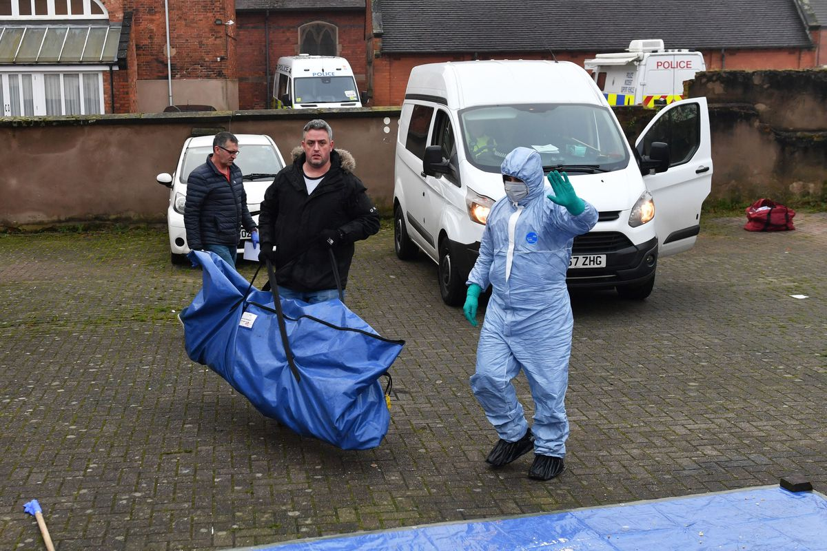 A forensic search team move evidence in Stafford. Credit: Jacob King/PA Wire