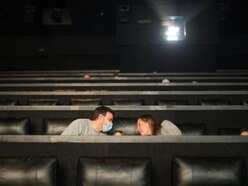 Customers welcome reopening of cinemas despite restrictions