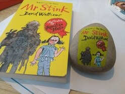 Miniature versions of classic front covers are being painted on to rocks