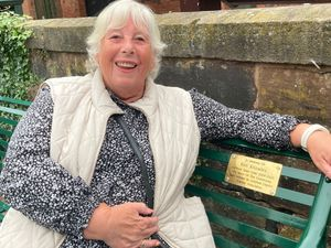Ken Knowles' partner Marilyn Masters with the bench plaque to Lichfield's beloved town crier.