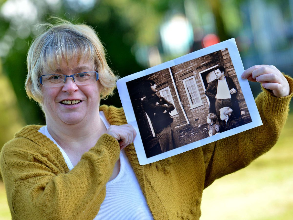 Joanne Smith with the picture she found of herself as part of the 'Forgotten People' photos from The Scotlands Estate. She is on there as a child with her brother and Dad: Malcolm and Henry