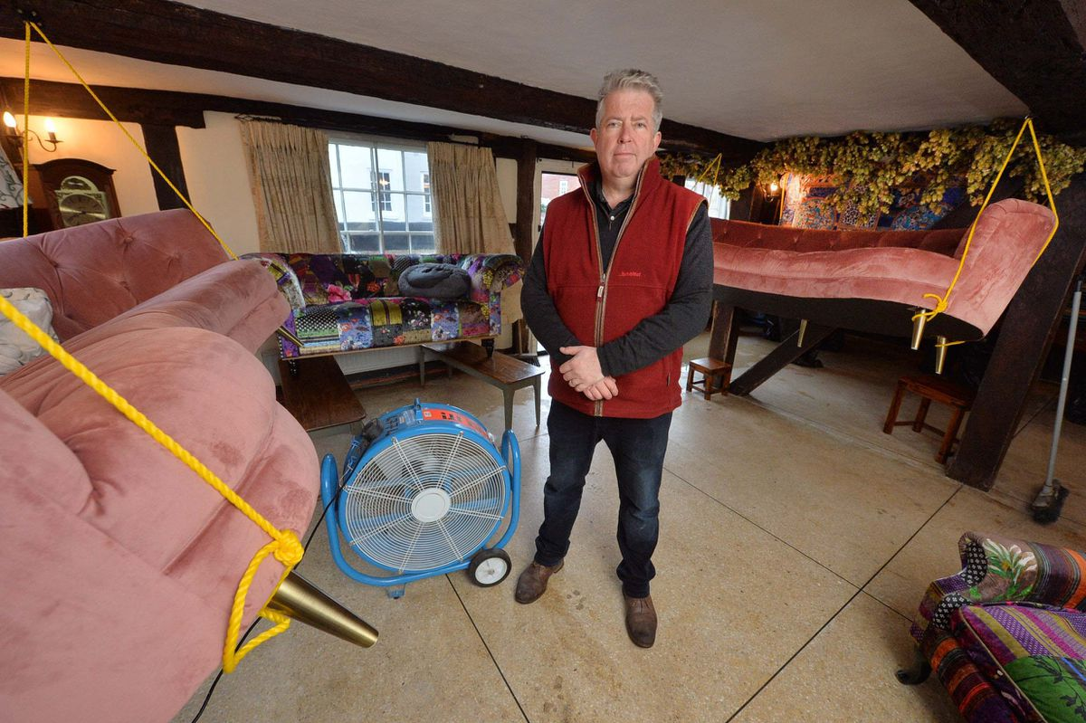 Inside David Hegarty's home. The carpets have been binned but he harnesses the furniture up in the air so they have been saved