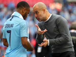 Pep Guardiola, right, and Raheem Sterling, left