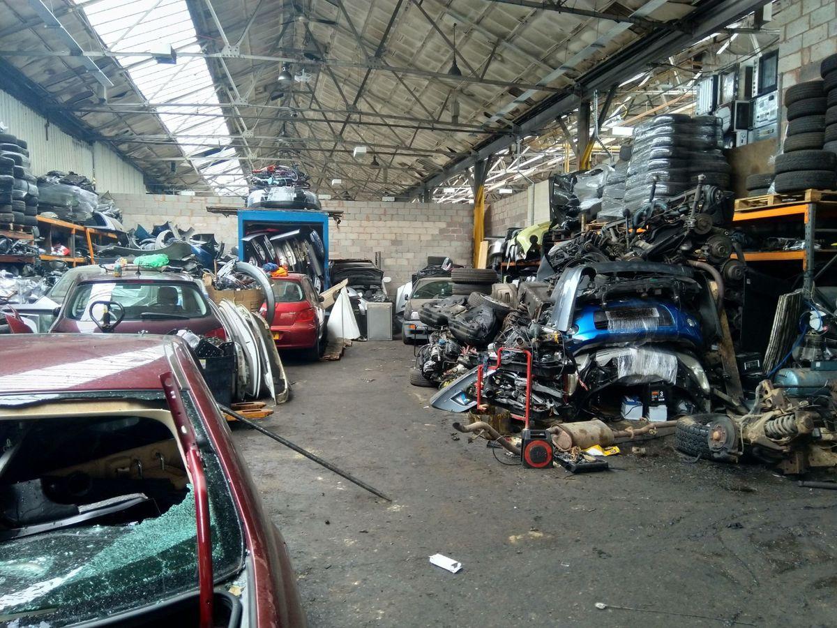 Scrap car parts inside a warehouse