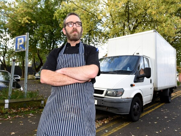 Butcher blocks free car park with van claiming commuters ruin his trade