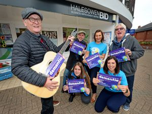 Tom Stanton with his guitar and fellow musician Billy Spakemon join Keith Horsfall, CEO of Leaps and Bounds, and Katie Davies, Vicky Rogers and Ellie Hunt from Halesowen BID, as they show their support to make Halesowen a dementia friendly town