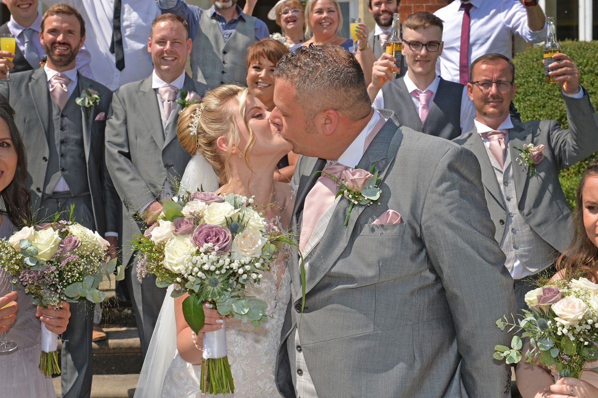 The happy couple share a kiss after becoming Mr and Mrs Whitehouse
