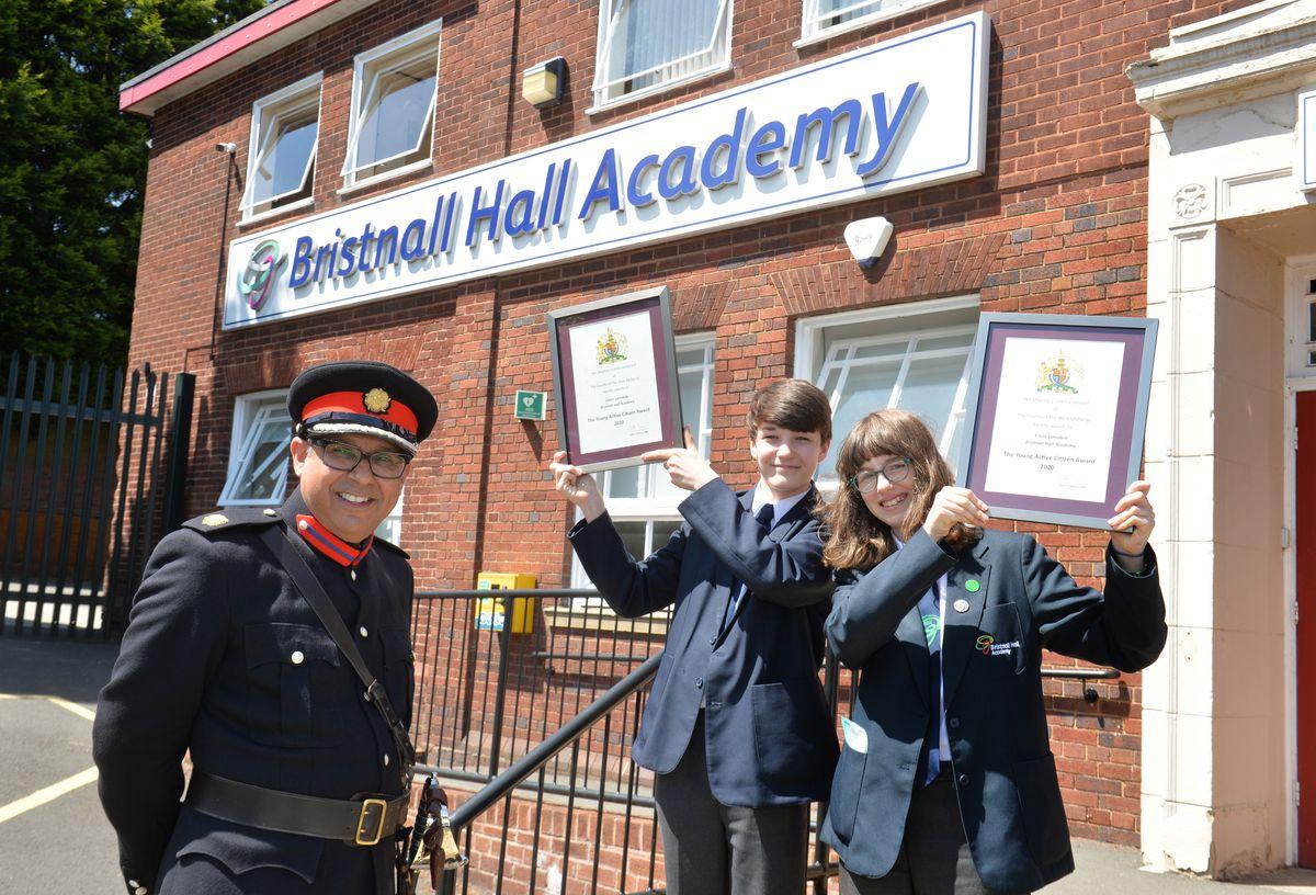 West Midlands Deputy Lieutenant Gurpreet Bhatia, presents students Oliver Lonsdale, aged 13, and Emily Lonsdale, aged 15, with the Lord-Lieutenants Young Active Citizen Award, at Bristnall Hall Academy, Oldbury