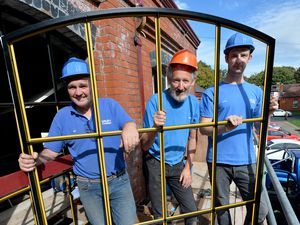 Ian Lawrence, Alec Brew and John Jacks help to install the new windows at the Tettenhall Transport Heritage Centre