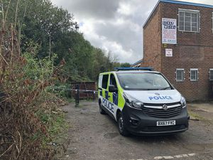 A police van at the scene of the double murder in Brierley Hill