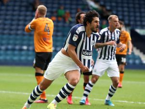 Ahmed Hegazi of West Bromwich Albion celebrates after scoring a goal to make it 2-1.