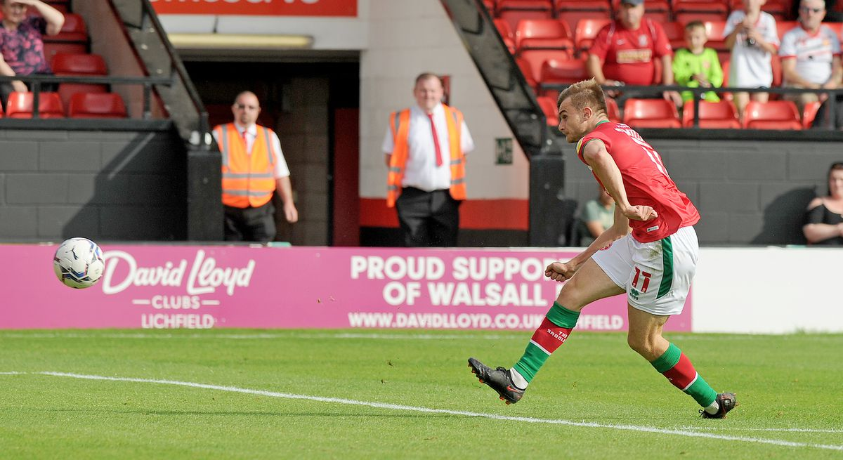 George Miller scores his second goal...