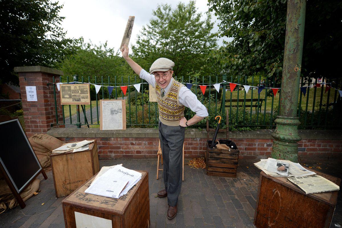 Edd Miller selling newspapers