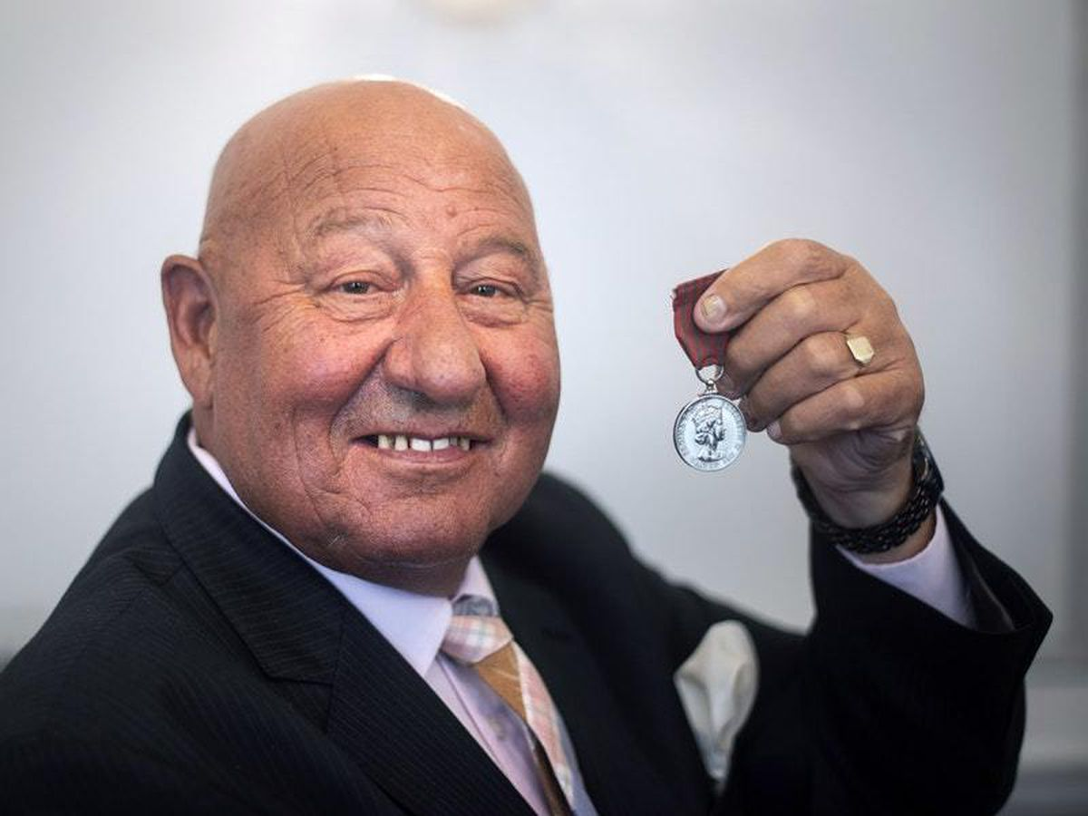 Ronnie Russell poses with the George Medal