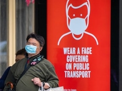 Use face coverings where social distancing not possible, new WHO advice says