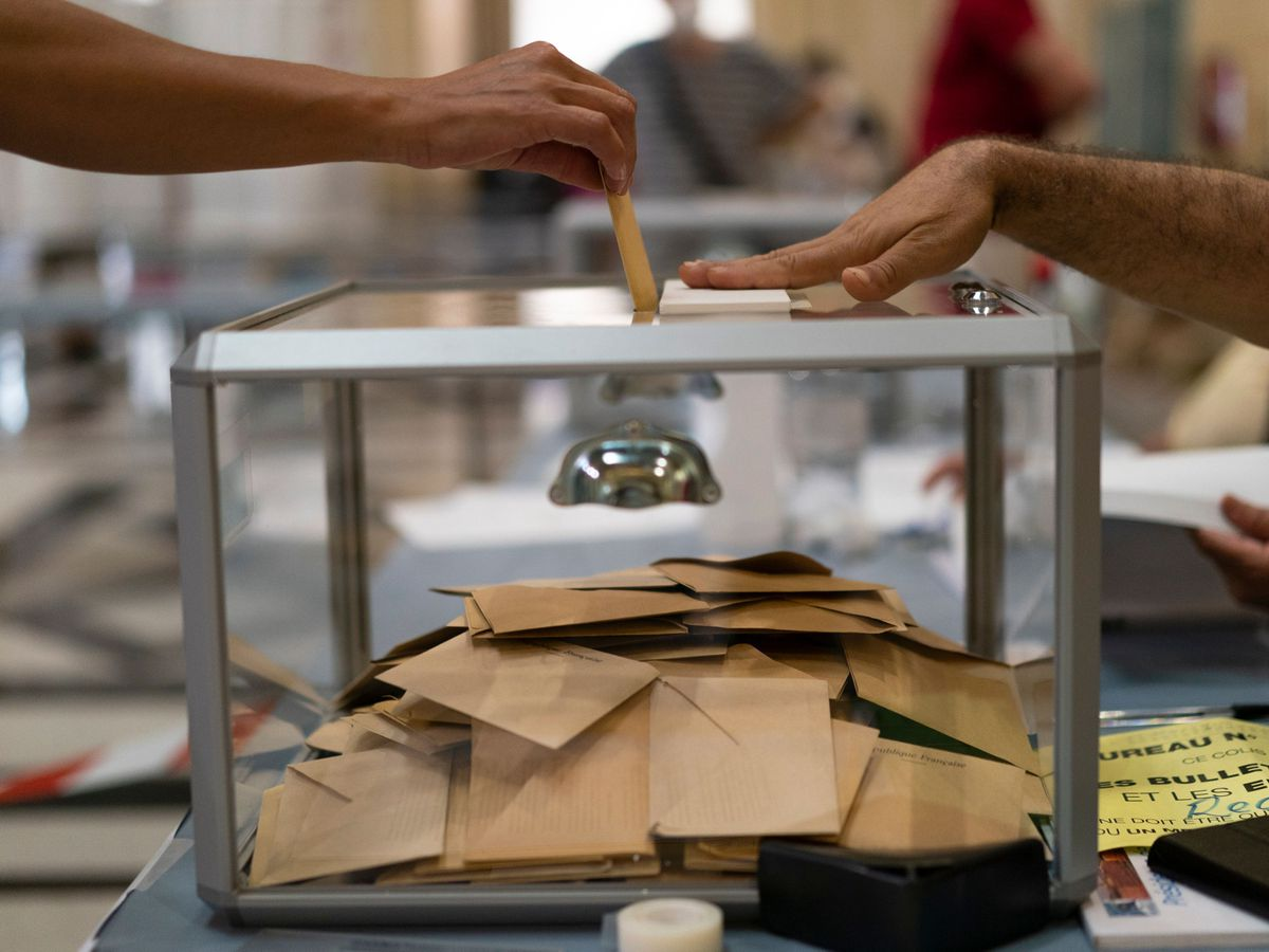 A woman casts her vote during regional elections in Marseille