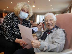 Nurse reads letter for care home resident