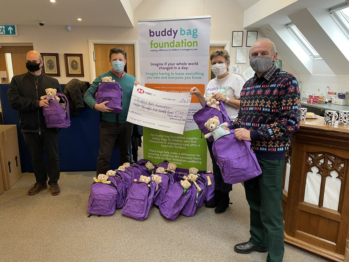 Karen Williams, Buddy Bag Foundation CEO, with, from left, Howard Smith, Philip Hall and Rod Hinton from the Freemasons
