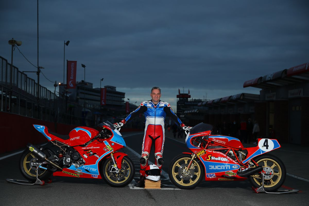 Rutter rode a BMW, left, painted in the same colours as his father's famous Ducati. Picture: Double Red