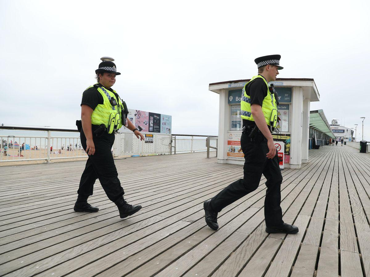 Police patrol near Bournemouth Pier (Andrew Matthews/PA)