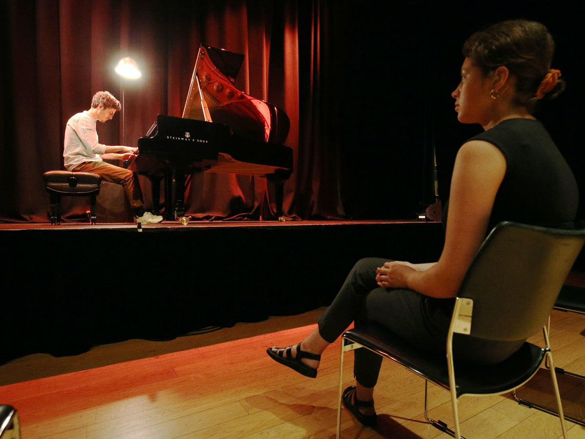 Pianist Elliot Galvin performs to a limited audience during the launch of Kings Place London's one-on-one Culture Clinics, where solo spectators watch from a safe social distance
