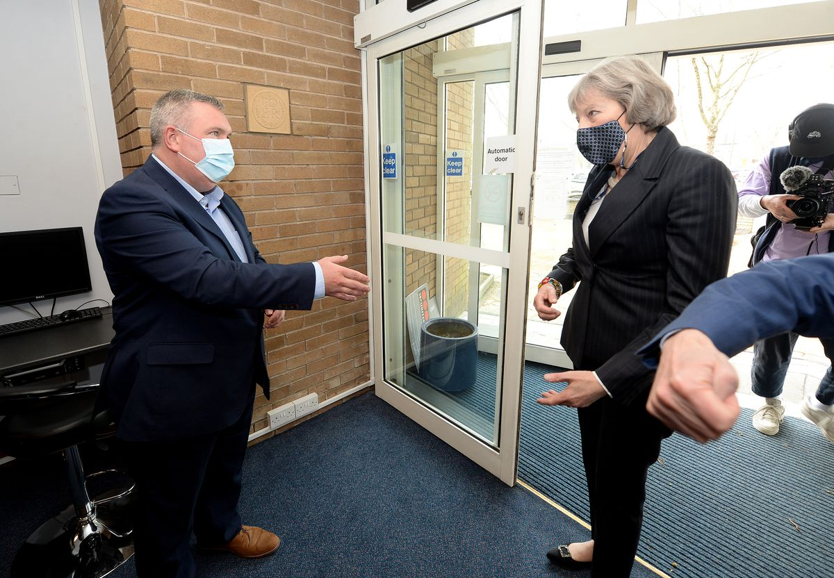 Deputy Walsall Council leader Adrian Andrew greets former Prime Minister Theresa May