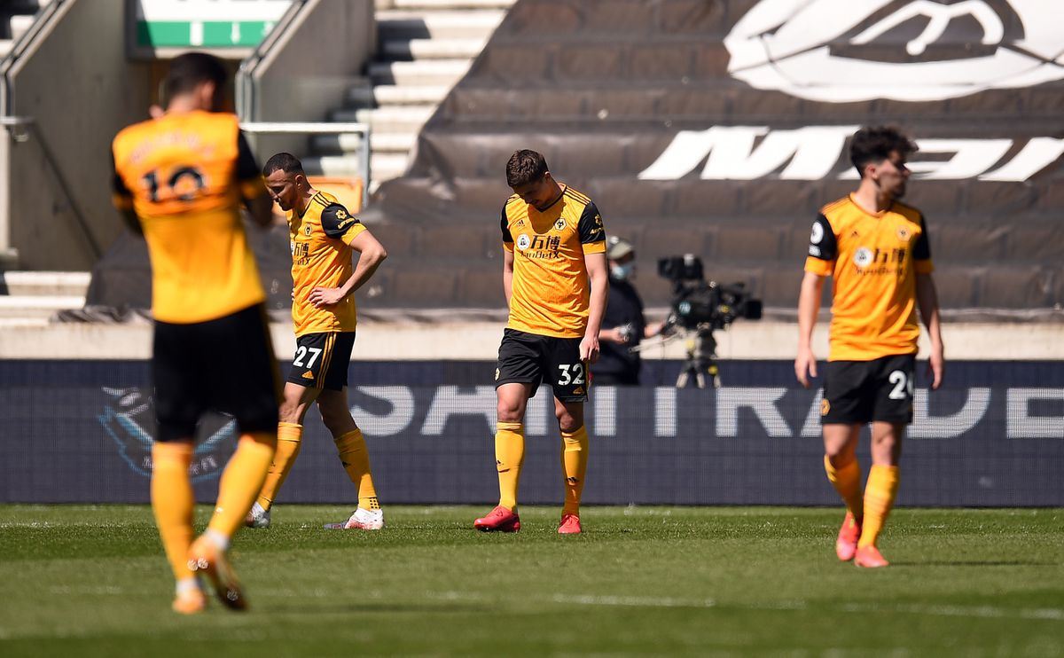 Wolverhampton Wanderers players appear dejected after they concede a fourth goal (PA)
