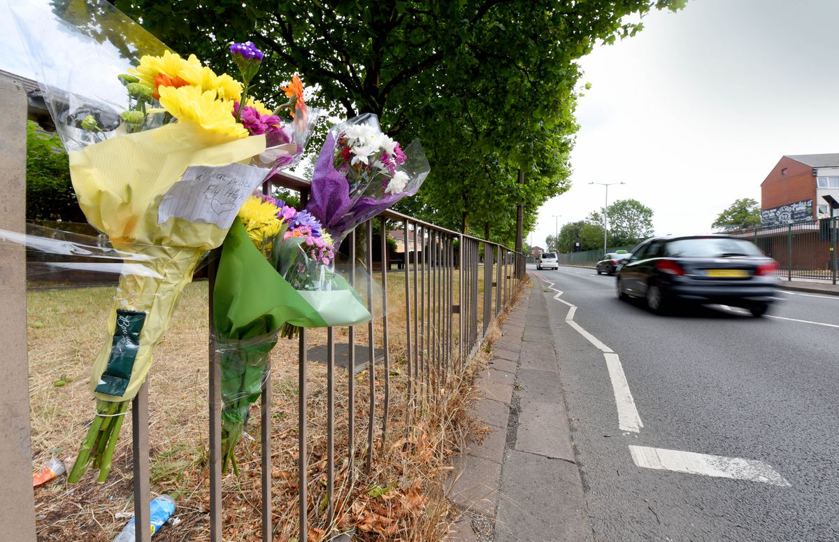 Floral tributes left next to the scene of the crash