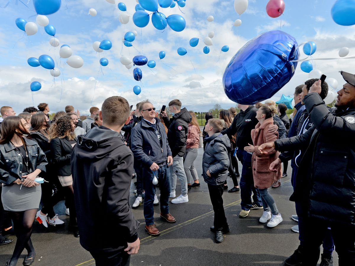 Farley's family watch the balloons