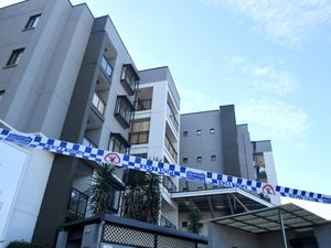 Police tape is seen at a lock-downed apartment building in the south western suburb of Blacktown in Sydney (Mick Tsikas/AAP Image via AP)