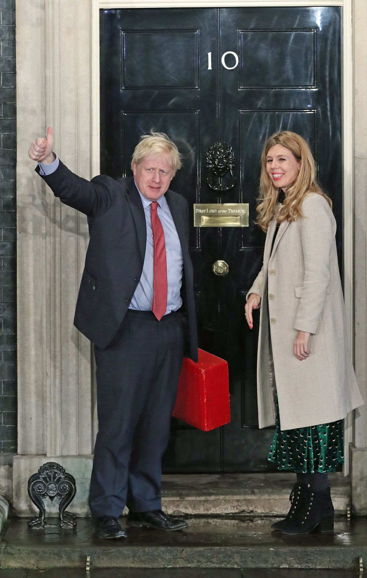 Prime Minister Boris Johnson and his girlfriend Carrie Symonds arrive in Downing Street after the Conservative Party was returned to power in the General Election with an increased majority. PA Photo. Picture date: Friday December 13, 2019. See PA story POLITICS Election. Photo credit should read: Yui Mok/PA Wire