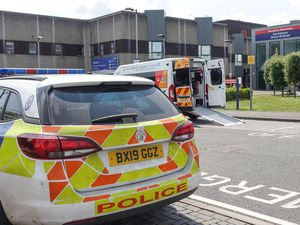 Police at the Emergency Department entrance of New Cross Hospital in Wolverhampton after a member of staff was stabbed. Photo: SnapperSK