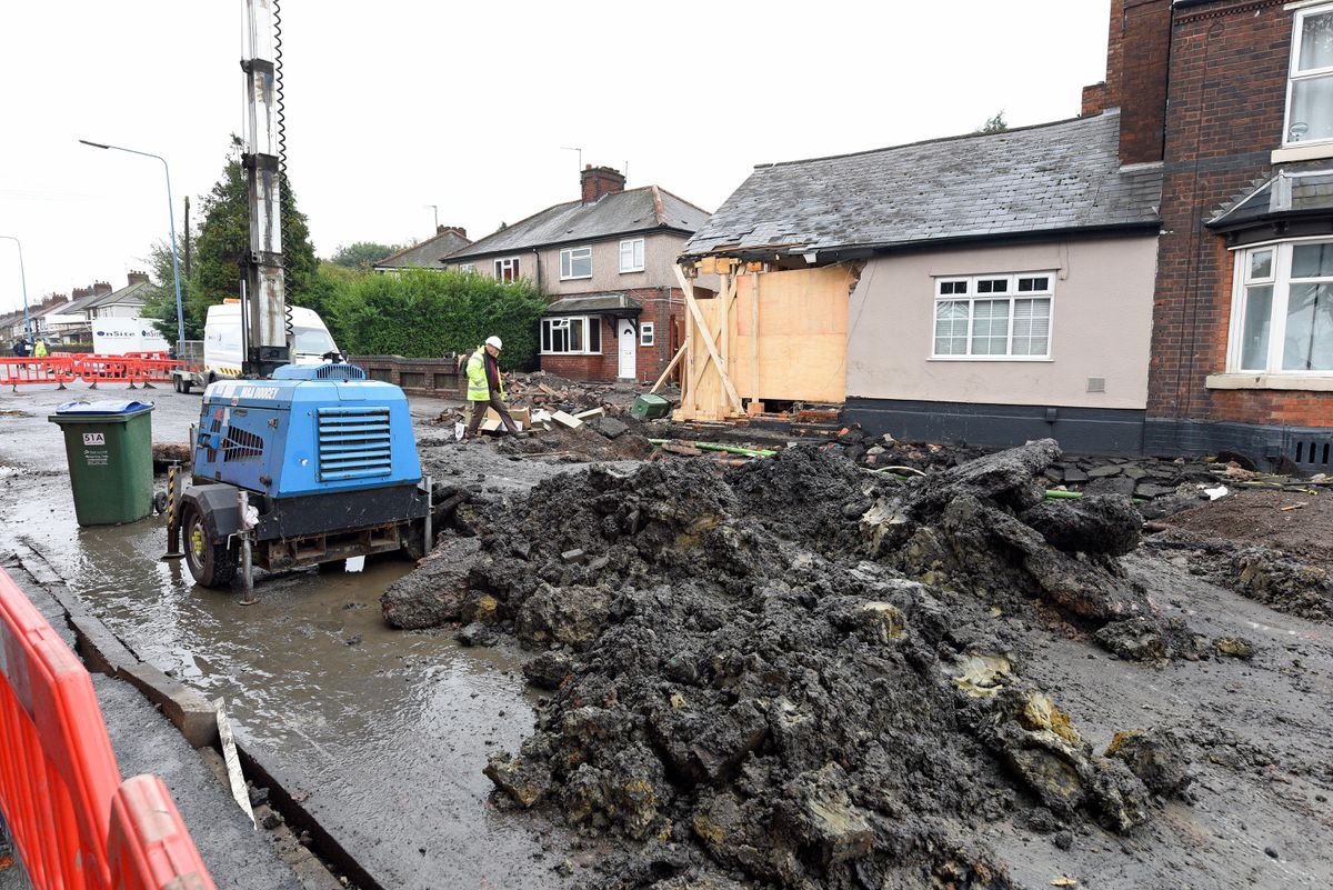 The scene in Park Lane West, Tipton, after a burst water main wrecked a house
