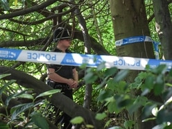 Forensic police searching Handsworth cemetery over woman's remains found in suitcases