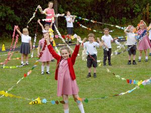 Fern Marsh aged 7 joins fellow pupils as they attempt the World Record for a chain of paper hearts at St Chads C Of E First School, Westbeech Rd, Pattingham, Wolverhampton