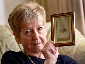 Iris Archer with a picture of her grandfather Benjamin Shepherd
