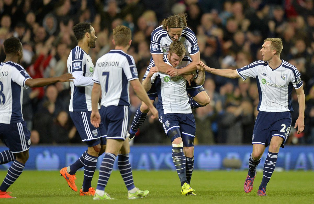 Chris Brunt of West Bromwich Albion celebrates after he scores a goal to make it 3-0 with Jonas Olsson of West Bromwich Albion (AMA)
