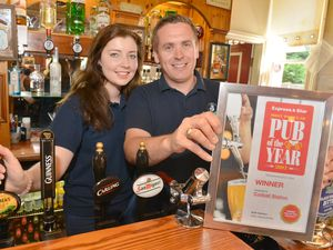 Toby Lardner and Megan Sadler celebrate after winning the Express & Star Pub of the Year award at The Station