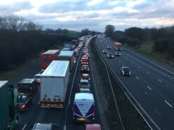Hour-long delays on M6 after lorry and cars crash