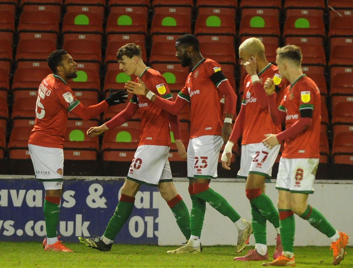 Emmanuel Osadebe celebrates his goal