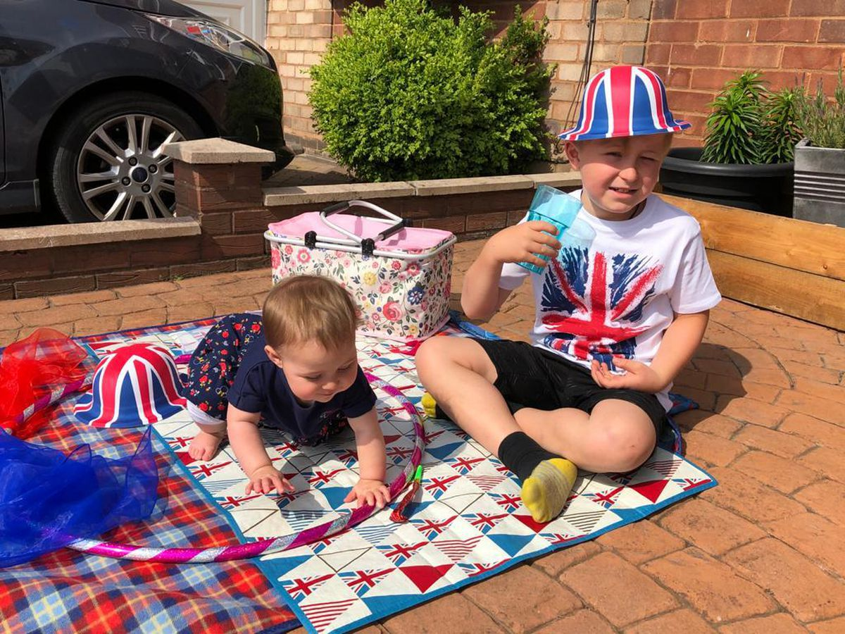 George Whitehouse, 8, and Violet, nine months, from Sedgley celebrating VE Day