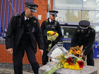 Tributes paid as 'much-loved' Met Police officer shot dead is named