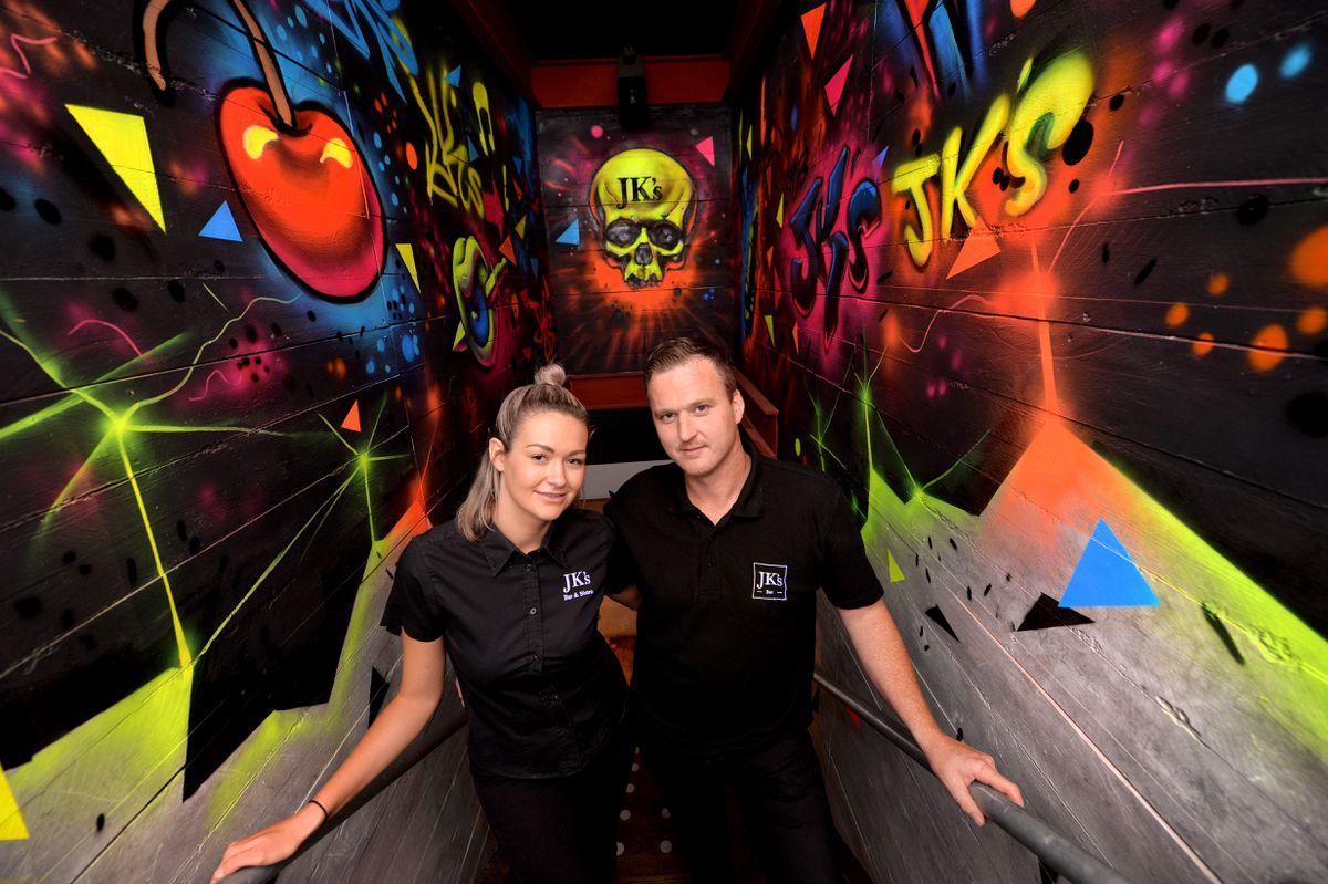 Victoria and Gary Millward ay JK's Bar with the main artwork